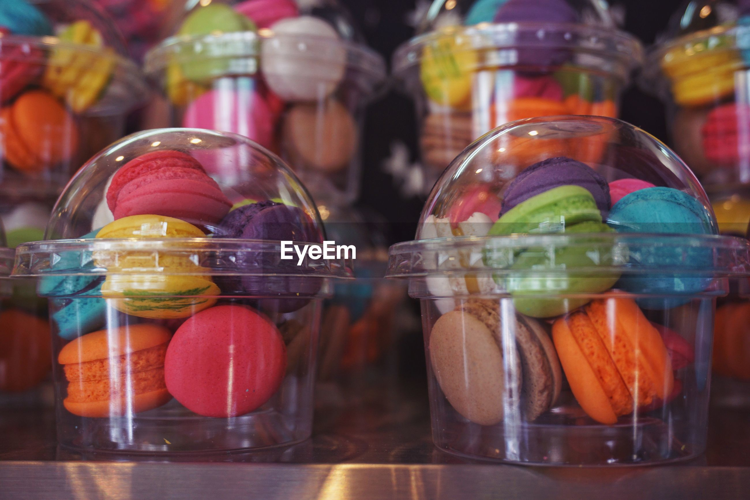 CLOSE-UP OF FRUITS IN JAR WITH CANDIES