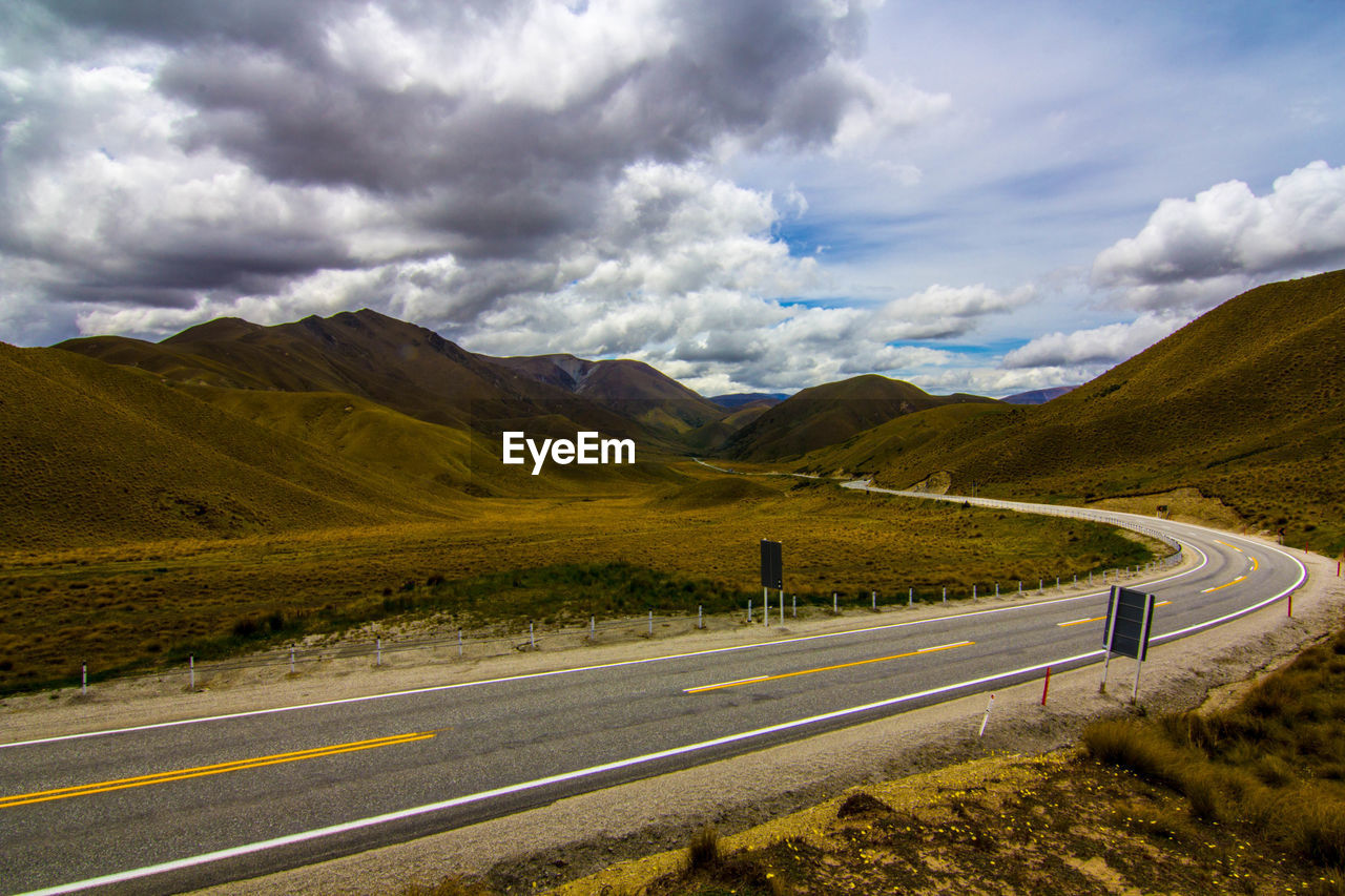 Scenic View Of Road By Mountain Against Sky