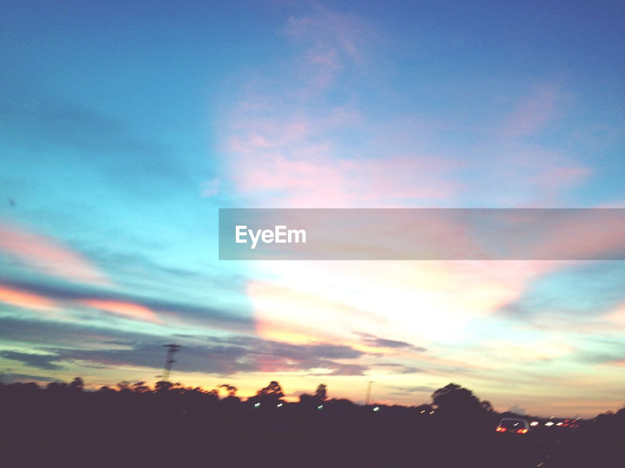 sky, sunset, silhouette, cloud - sky, scenics, beauty in nature, no people, nature, tranquility, outdoors, low angle view, tree, city, day