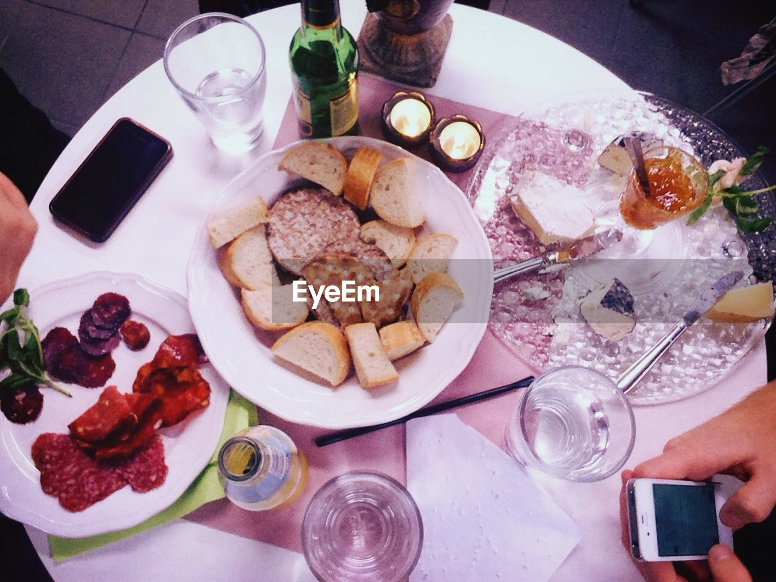 food and drink, freshness, food, indoors, person, ready-to-eat, holding, indulgence, drinking glass, table, drink, plate, part of, sweet food, high angle view, refreshment, lifestyles