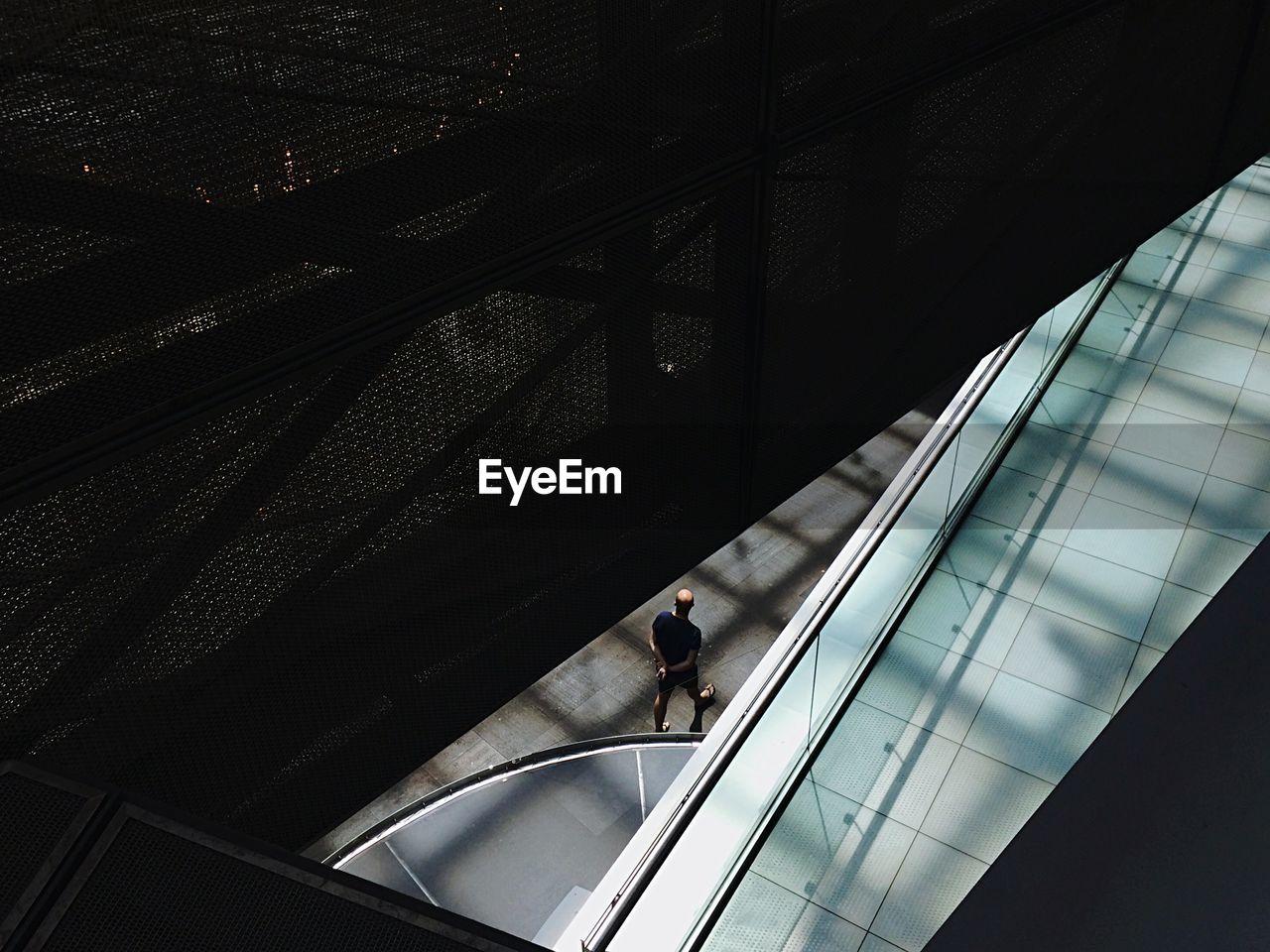 High Angle View Of Man Walking On Sidewalk