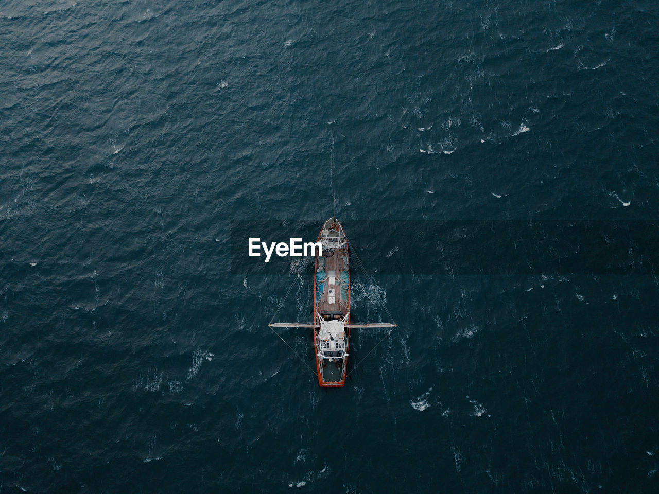 Aerial View Of Boat Sailing In Sea