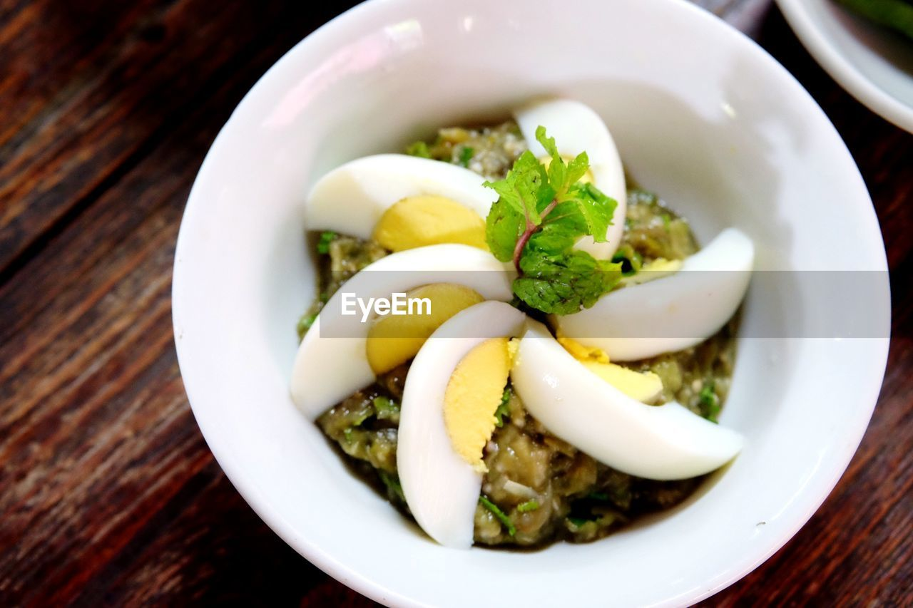 High angle view of food with garnishing of egg slices in bowl