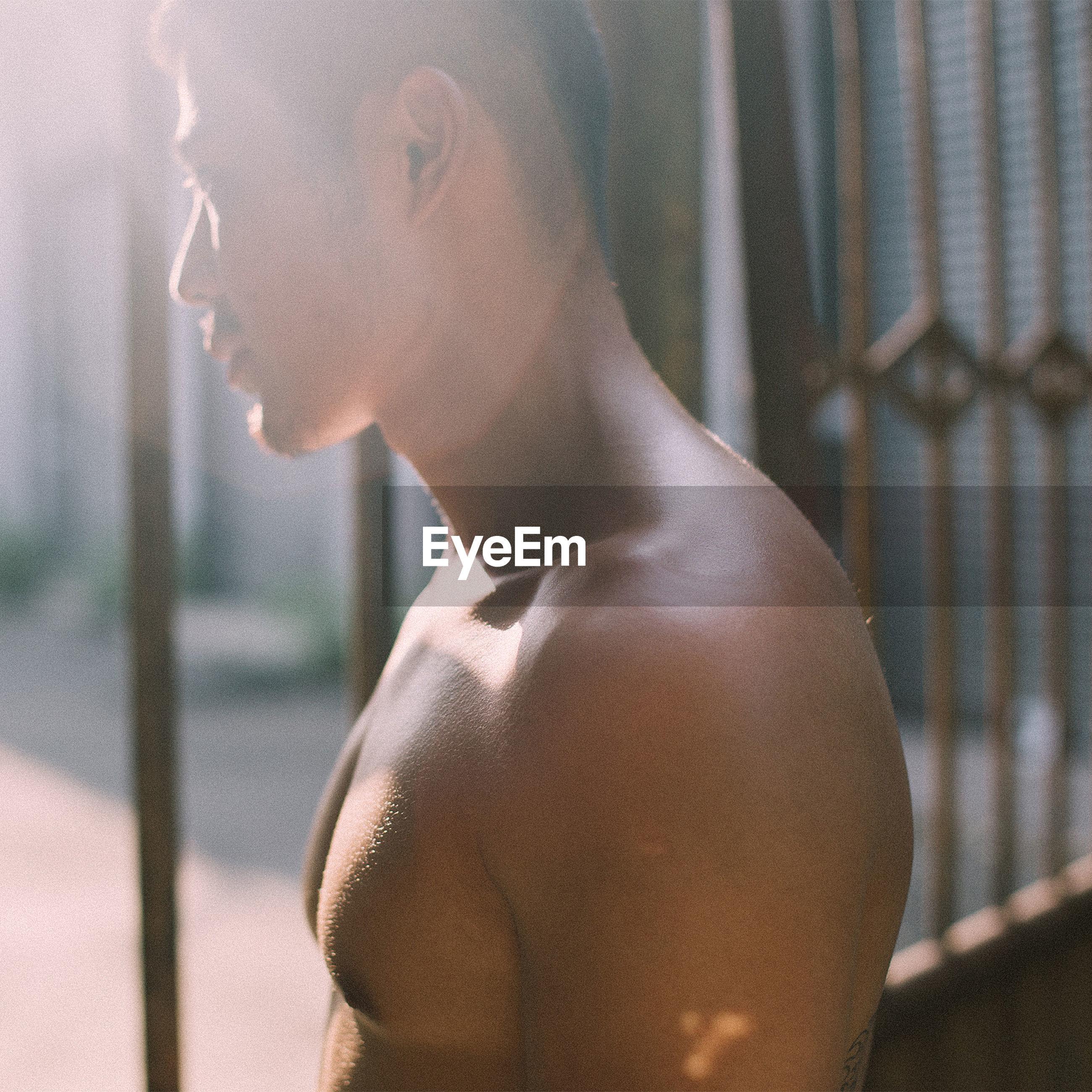 Close-up of shirtless young man