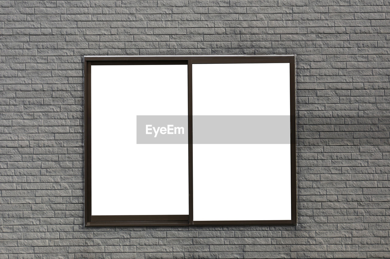 brick, copy space, brick wall, blank, wall - building feature, wall, architecture, white color, no people, frame, built structure, indoors, picture frame, advertisement, rectangle, day, creativity, building, pattern, marketing