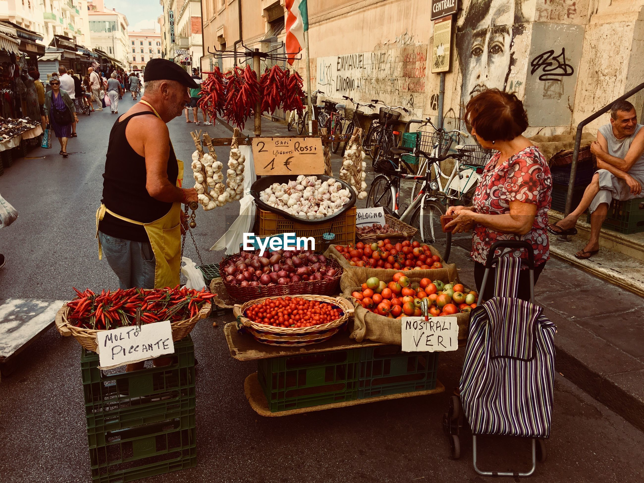 market stall, real people, market, retail, food and drink, for sale, food, variation, small business, choice, outdoors, abundance, healthy eating, day, price tag, vegetable, fruit, freshness, men, city, occupation, women, one person, people, adult
