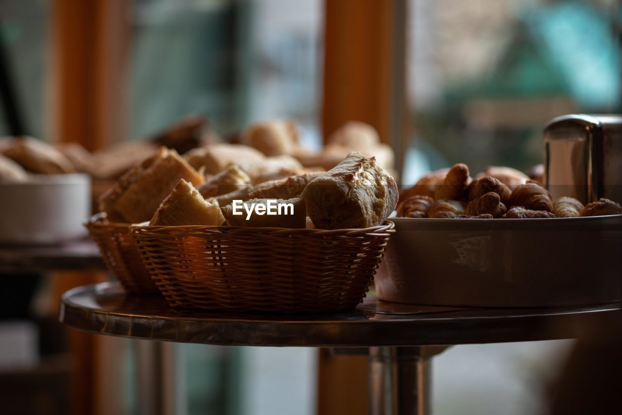 food and drink, food, freshness, basket, indoors, container, no people, focus on foreground, table, wicker, still life, selective focus, brown, close-up, healthy eating, ready-to-eat, wellbeing, day, indulgence, bread, temptation