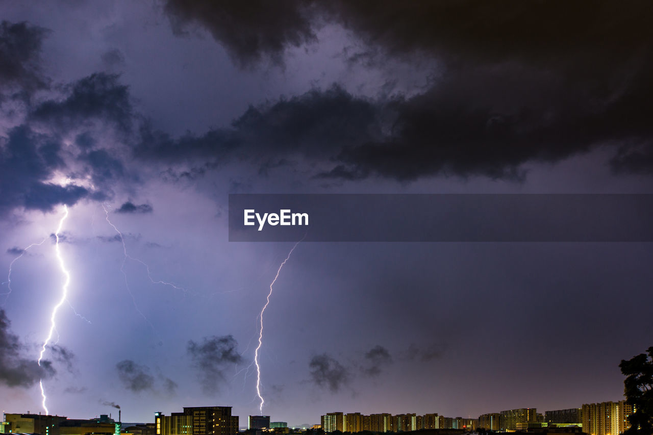cloud - sky, storm, sky, lightning, thunderstorm, power in nature, storm cloud, power, beauty in nature, forked lightning, building exterior, architecture, nature, warning sign, overcast, sign, communication, night, dramatic sky, no people, outdoors, ominous