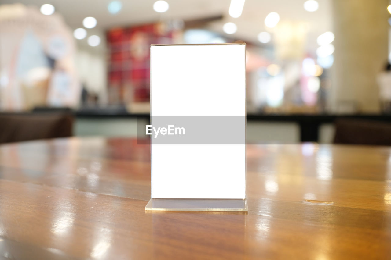 Close-up of blank menu on table at restaurant