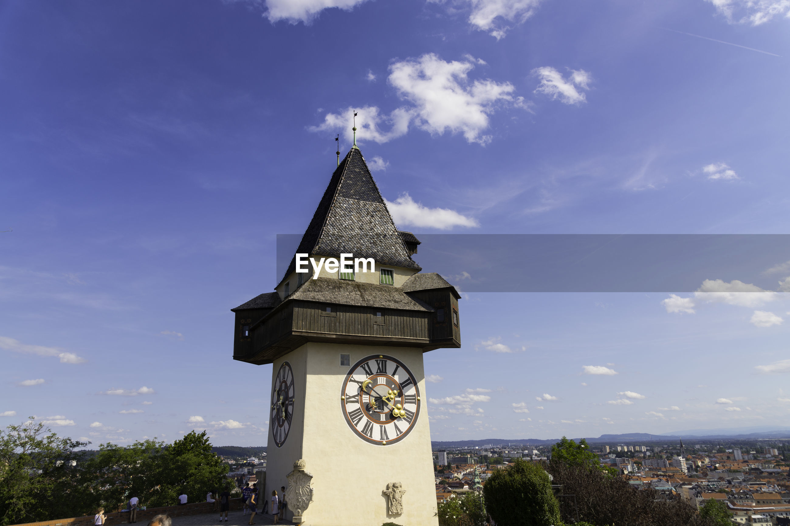 TOWER BY BUILDING AGAINST SKY