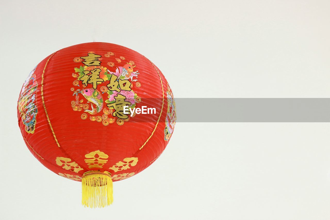 studio shot, white background, copy space, red, indoors, no people, lantern, decoration, still life, chinese lantern, single object, hanging, lighting equipment, cut out, orange color, close-up, art and craft, chinese new year, ornate, paper lantern
