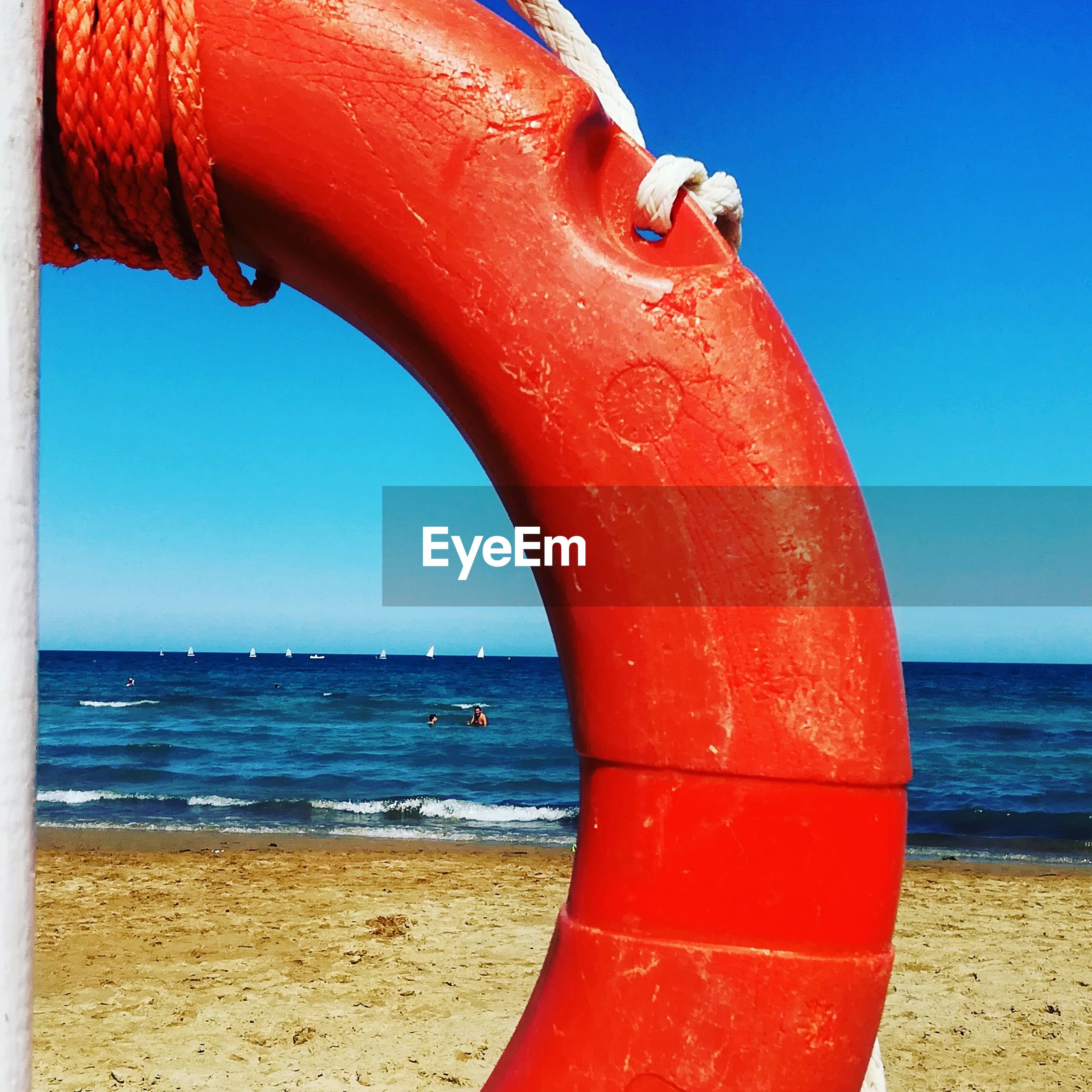 sea, water, horizon over water, red, sky, blue, beauty in nature, nature, day, tranquil scene, outdoors, sunlight, clear sky, no people, tranquility, scenics, nautical vessel, close-up