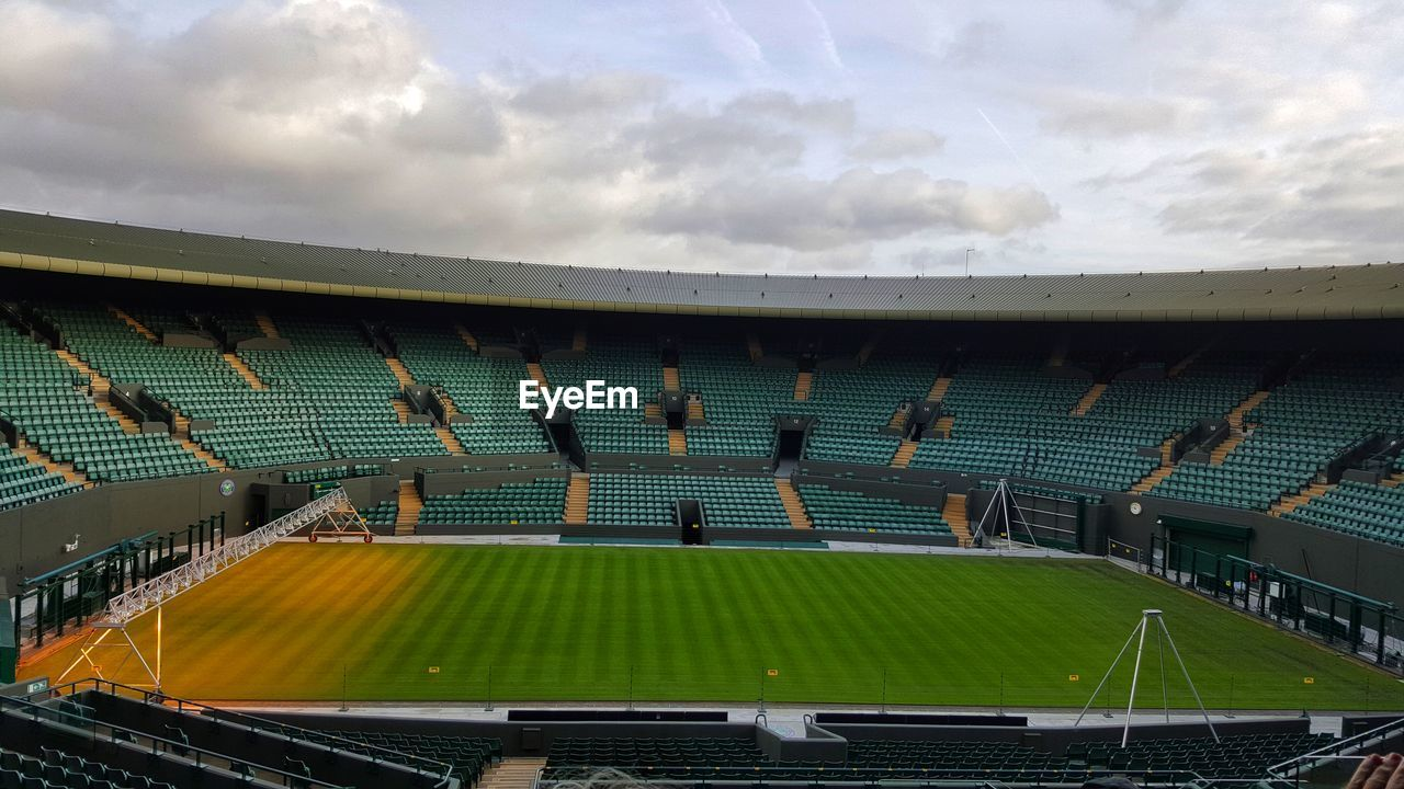 cloud - sky, sky, stadium, sport, built structure, architecture, nature, day, group of people, outdoors, competition, building exterior, empty, competitive sport, high angle view, playing field, team sport, roof, absence