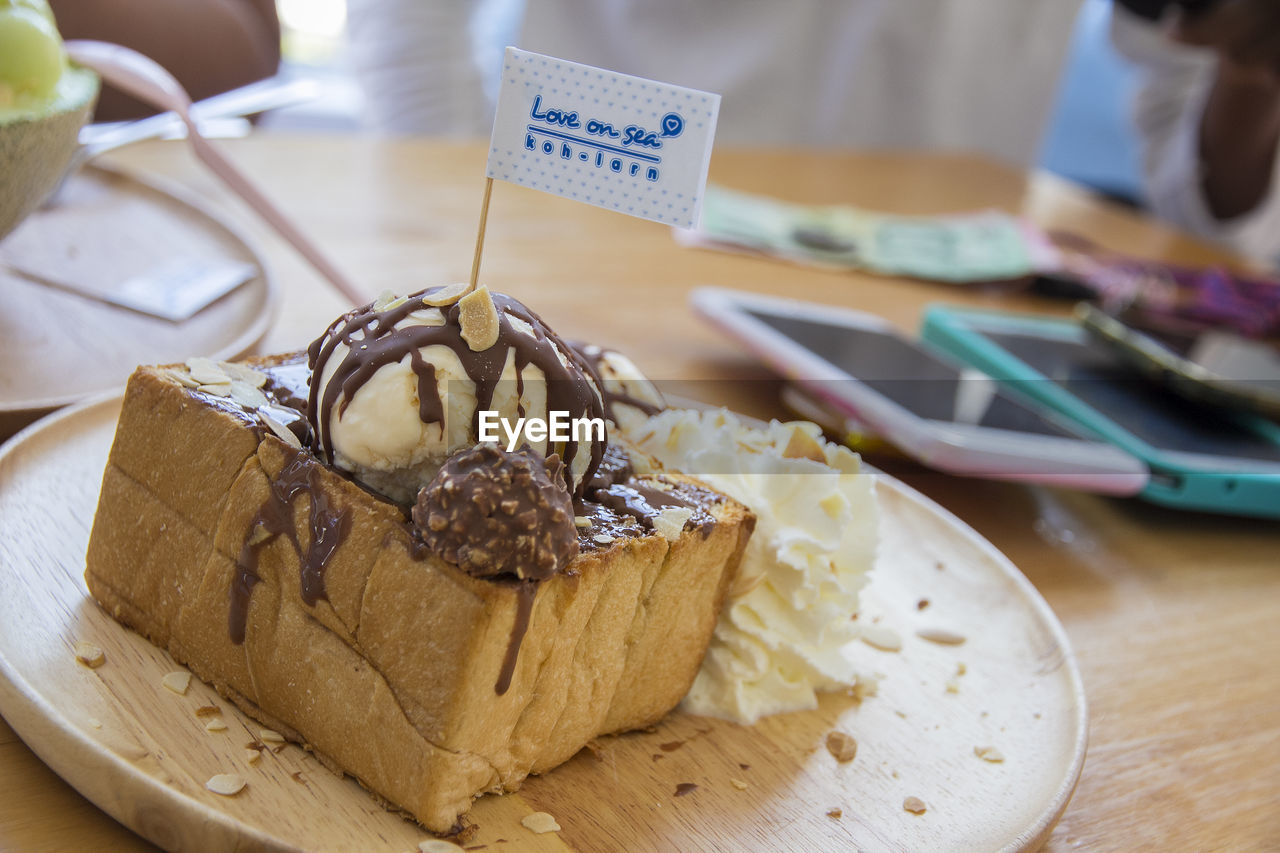 food and drink, food, freshness, table, close-up, ready-to-eat, still life, focus on foreground, indoors, sweet food, unhealthy eating, indulgence, baked, plate, text, no people, dessert, sweet, high angle view, temptation, french food