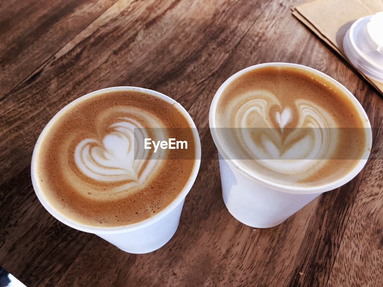 coffee cup, coffee - drink, frothy drink, drink, froth art, cappuccino, refreshment, table, food and drink, latte, saucer, wood - material, high angle view, freshness, indoors, no people, serving size, directly above, close-up, day, food, thick