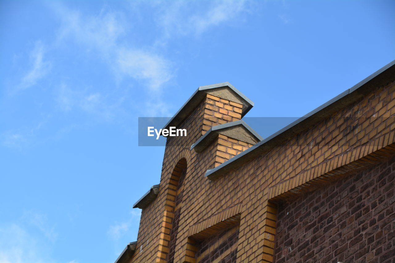 low angle view, architecture, sky, building exterior, built structure, day, outdoors, no people, blue