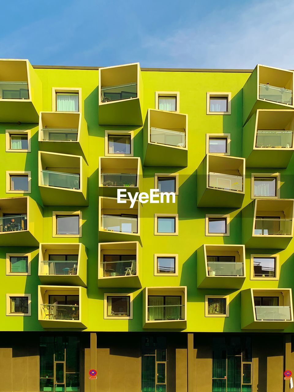 built structure, architecture, yellow, building exterior, no people, building, residential district, city, sky, day, window, outdoors, repetition, balcony, nature, side by side, multi colored, apartment, modern, in a row, skyscraper