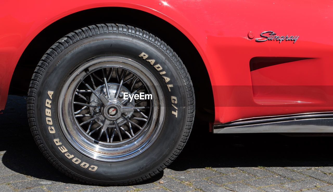 tire, wheel, transportation, red, car, rubber, day, outdoors, no people