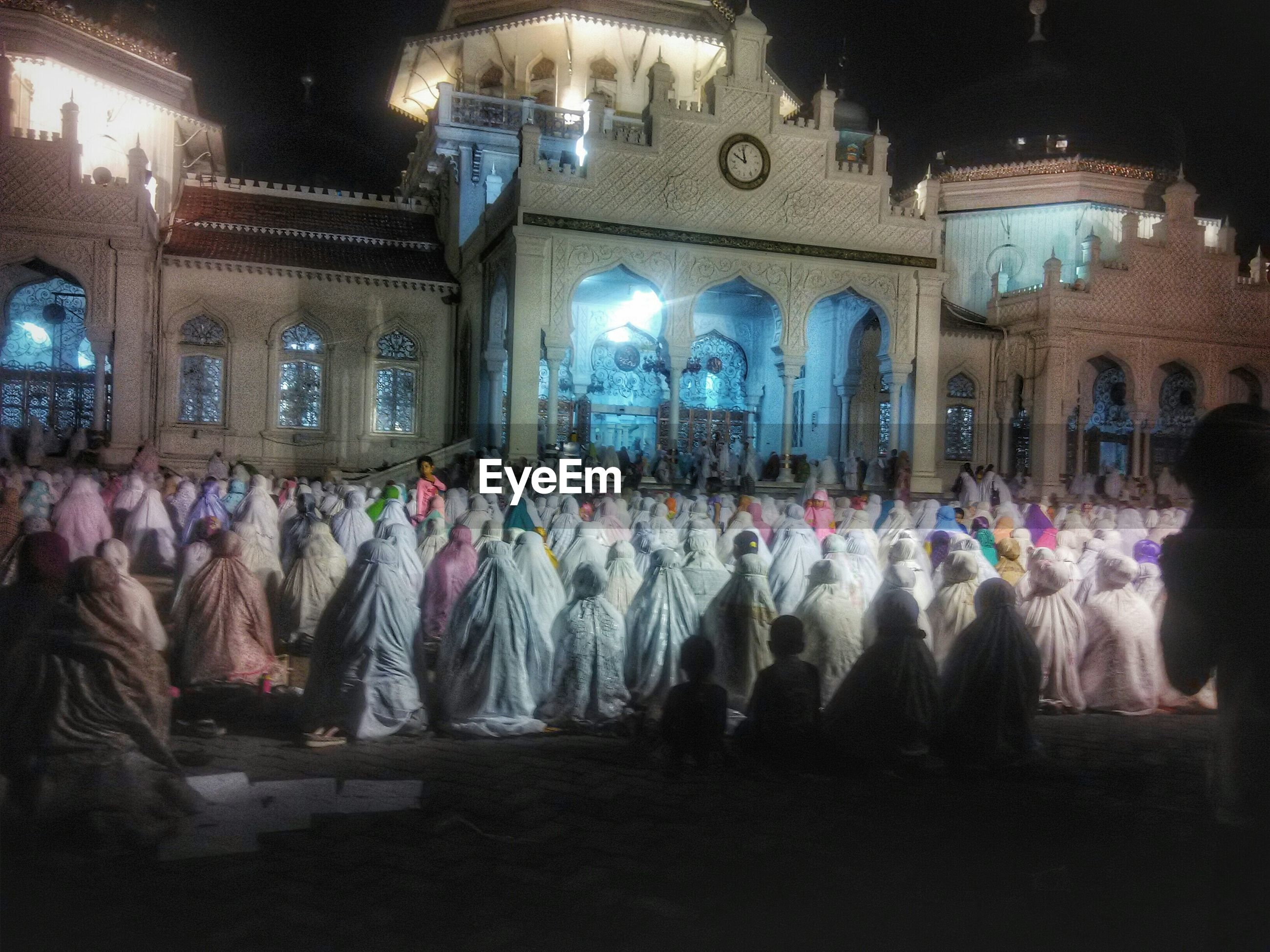 large group of people, crowd, men, person, lifestyles, leisure activity, night, illuminated, celebration, event, performance, arts culture and entertainment, standing, tradition, built structure, architecture, cultures, indoors