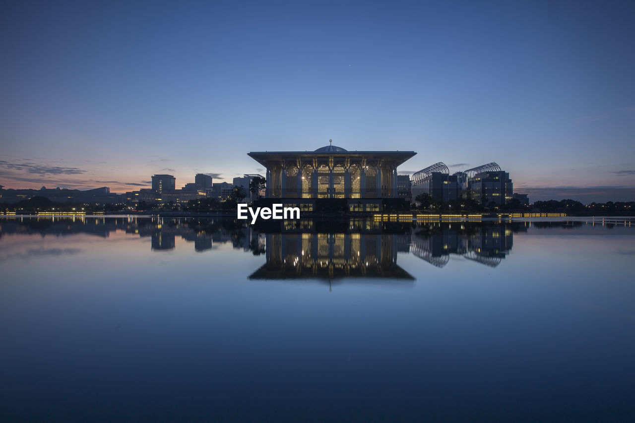 building exterior, architecture, built structure, sky, water, waterfront, reflection, lake, building, nature, copy space, illuminated, no people, travel destinations, dusk, outdoors, travel, standing water, symmetry