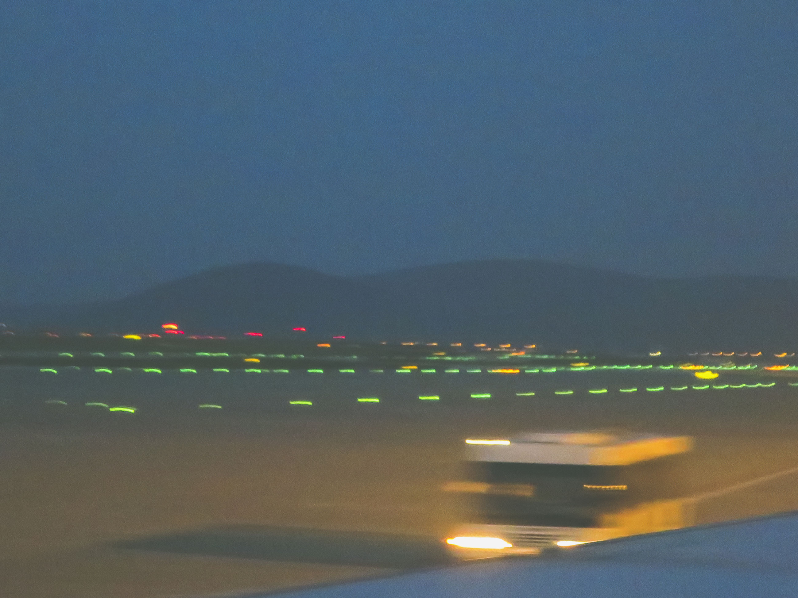 Light trails at airport against clear sky at night