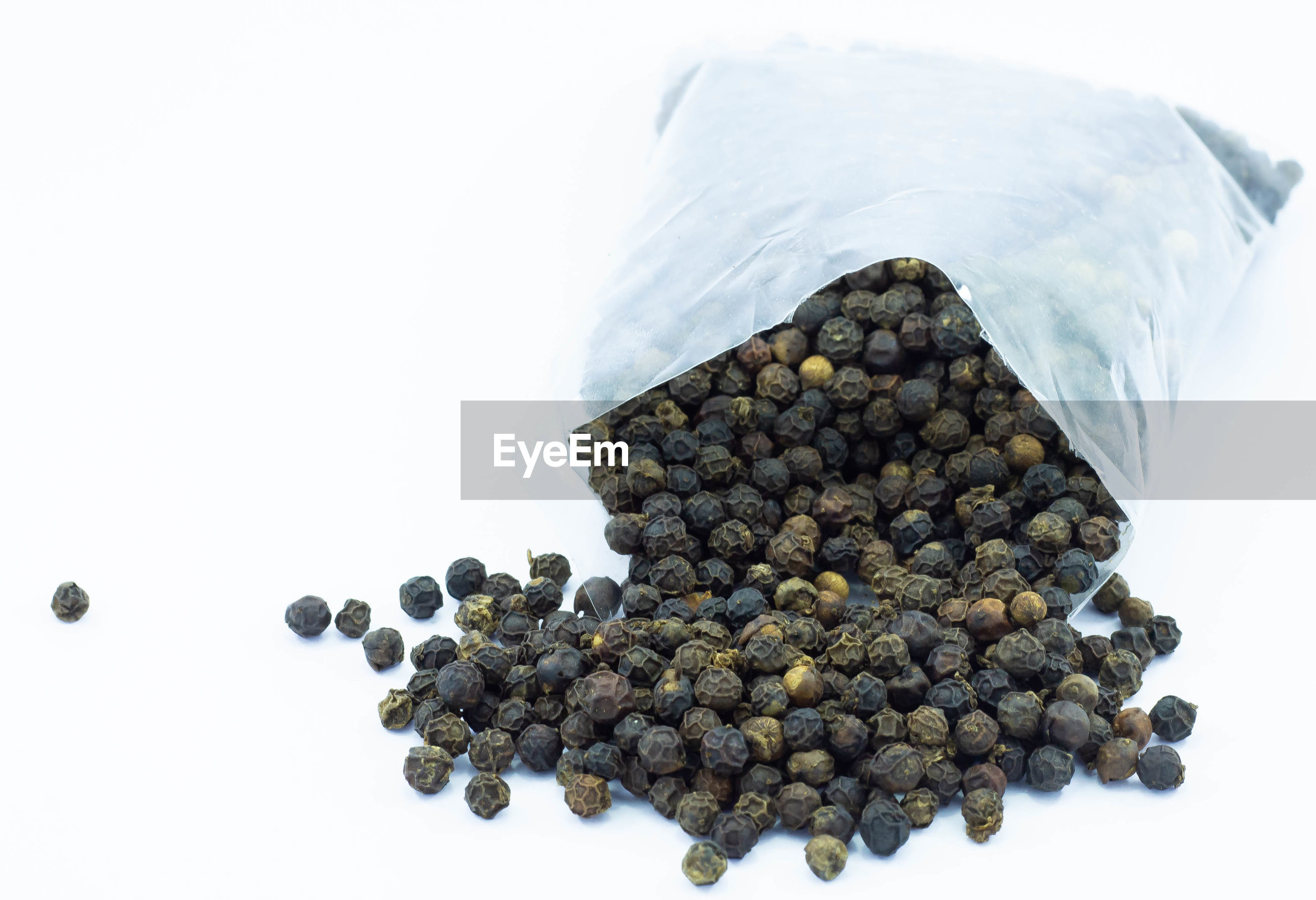 High angle view of pepper seeds on a white background