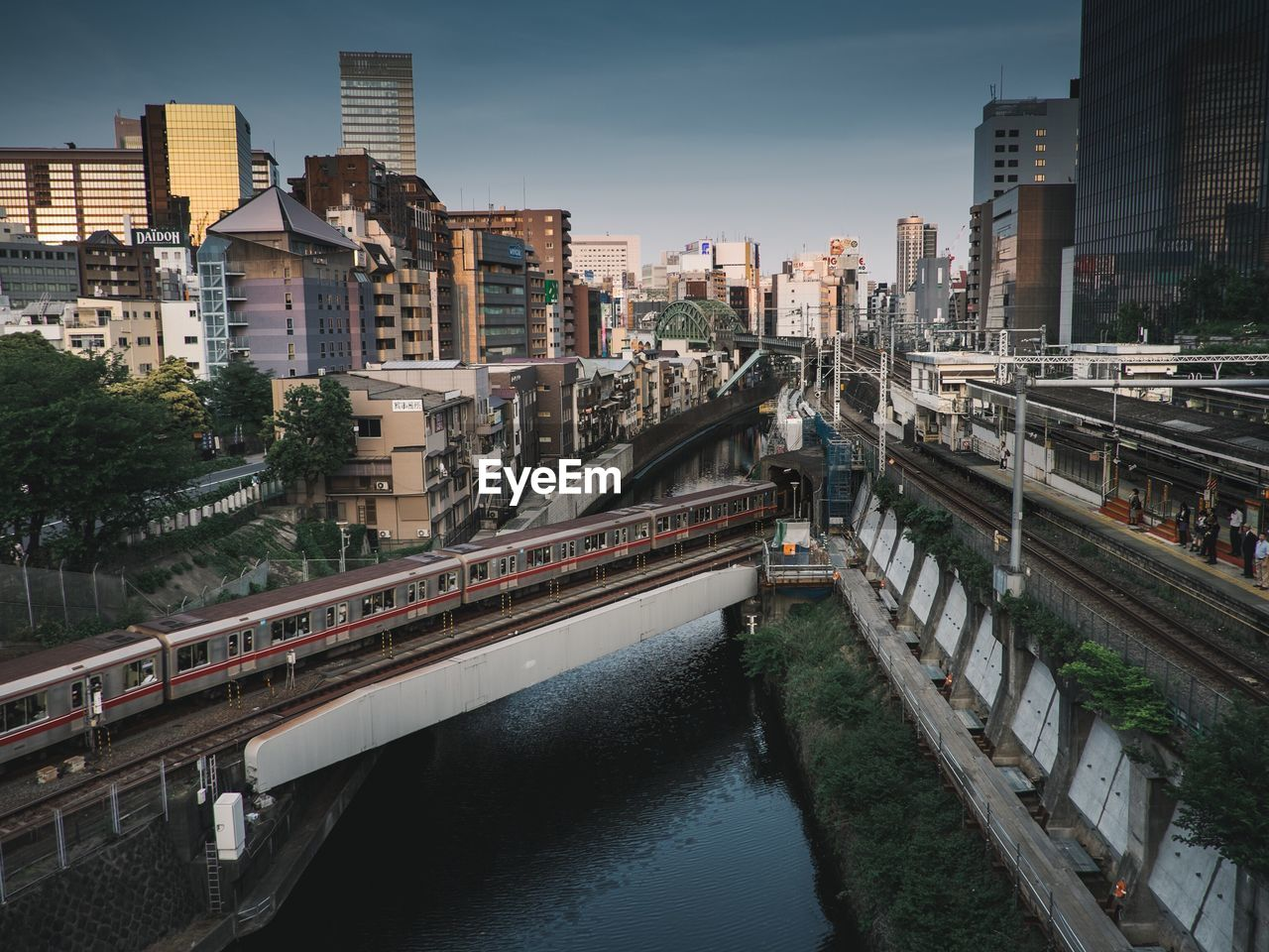 Metro Train Over Canal In City