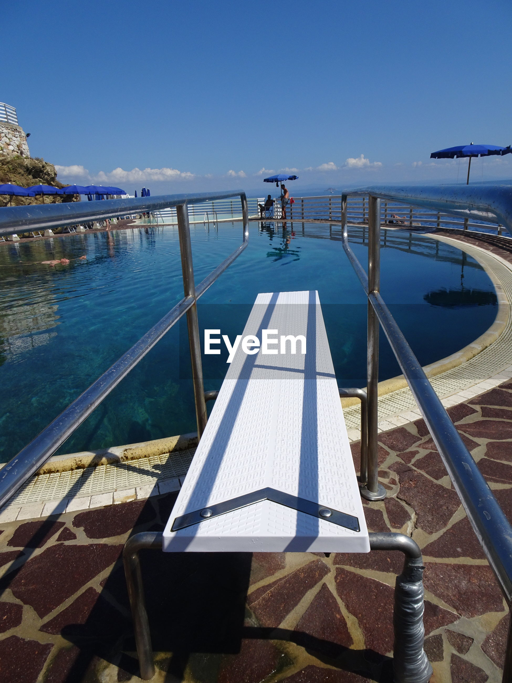 Pool over sea against blue sky