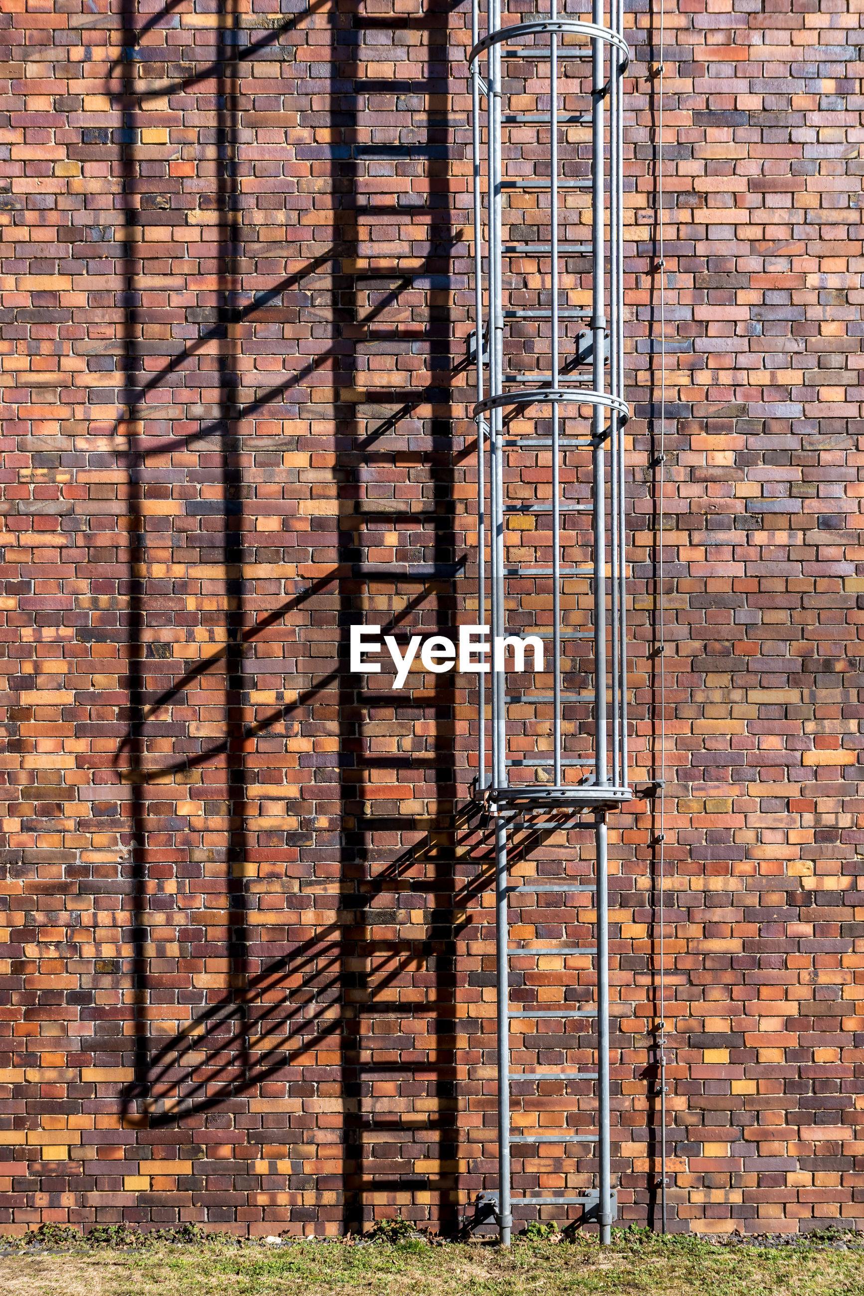 Fire escape against brick wall