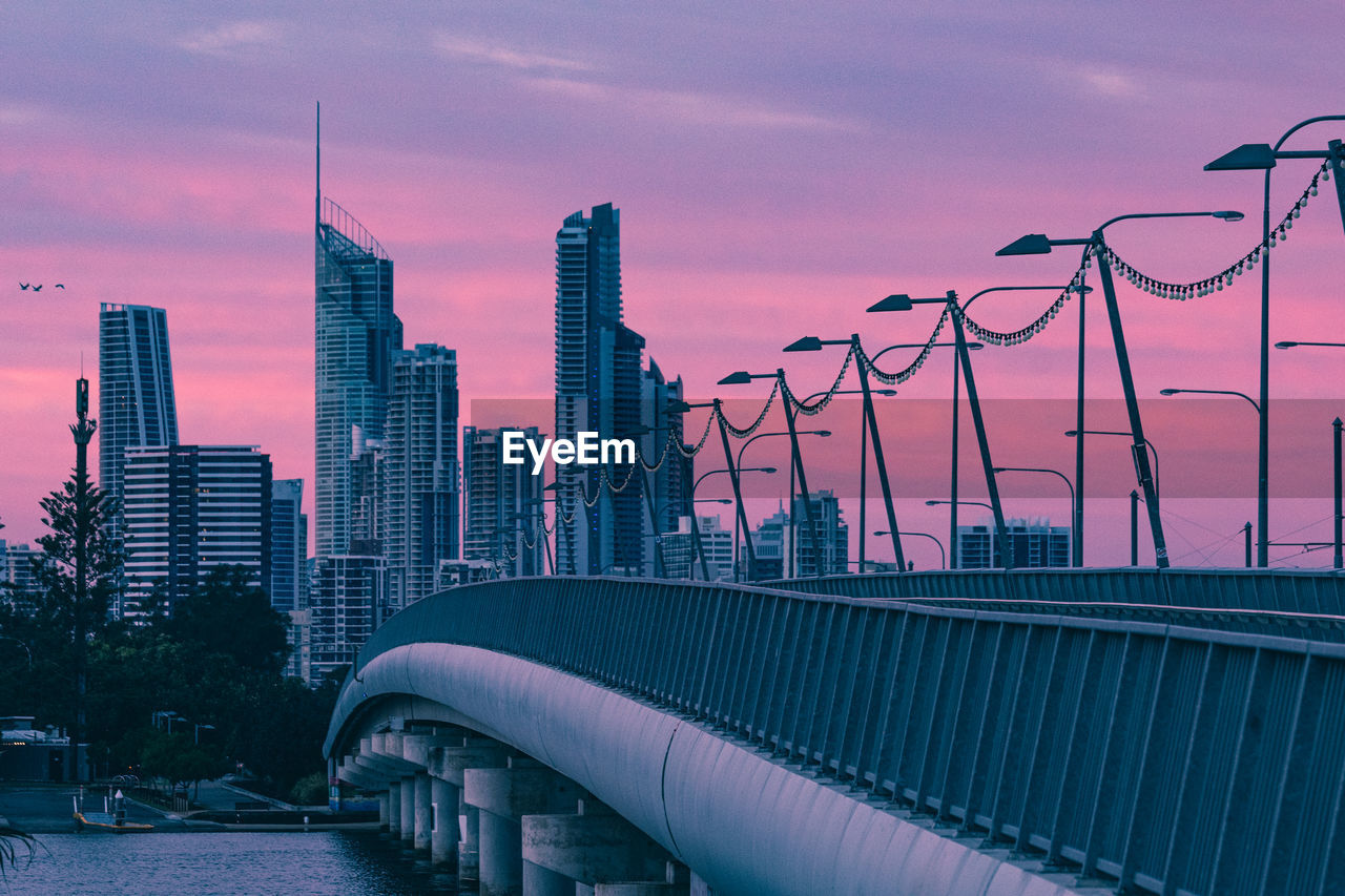 architecture, built structure, sky, building exterior, city, sunset, office building exterior, nature, building, cloud - sky, skyscraper, bridge, bridge - man made structure, transportation, cityscape, water, connection, modern, tall - high, no people, outdoors, financial district