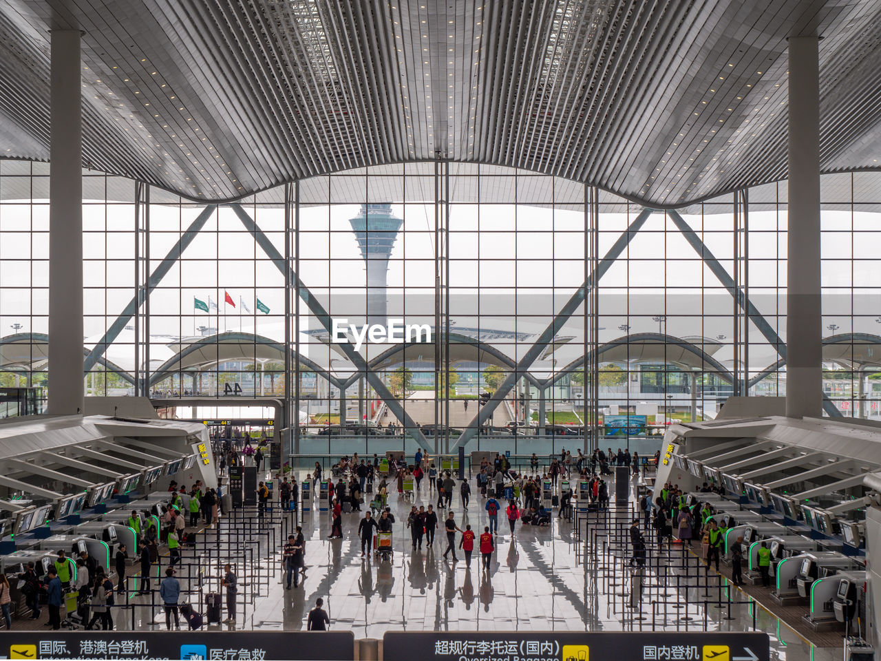 large group of people, group of people, crowd, real people, indoors, architecture, transportation, travel, built structure, men, women, ceiling, adult, passenger, mode of transportation, rail transportation, airport, day, lifestyles, waiting, modern, airport terminal, station