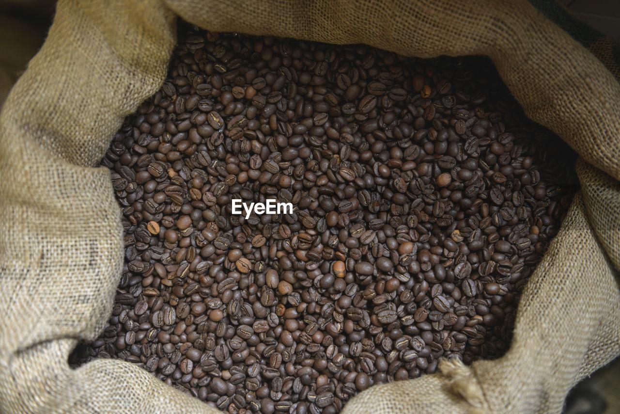 Roasted coffee beans in burlap sack