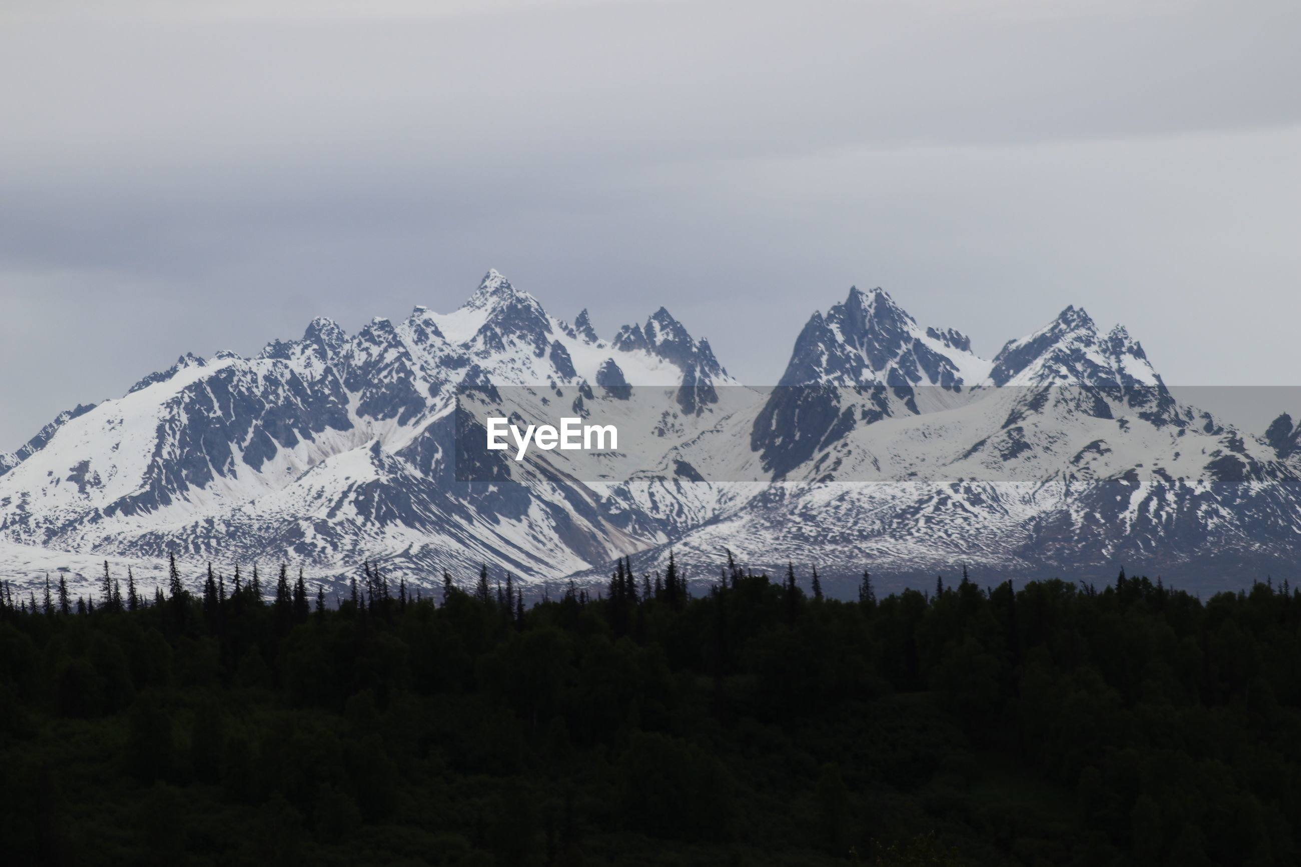 VIEW OF SNOWCAPPED MOUNTAIN AGAINST SKY