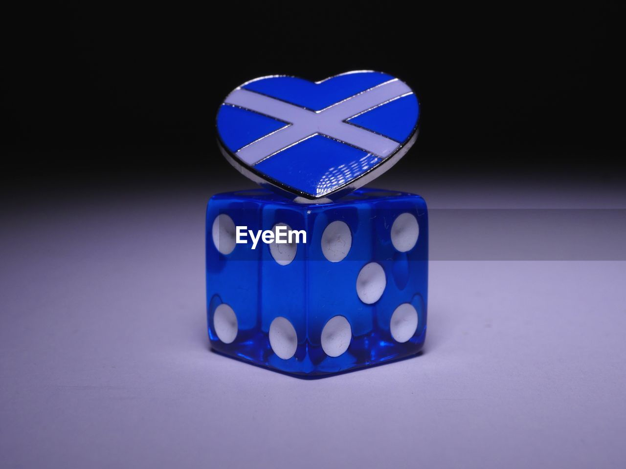 Close-up of blue dice on table