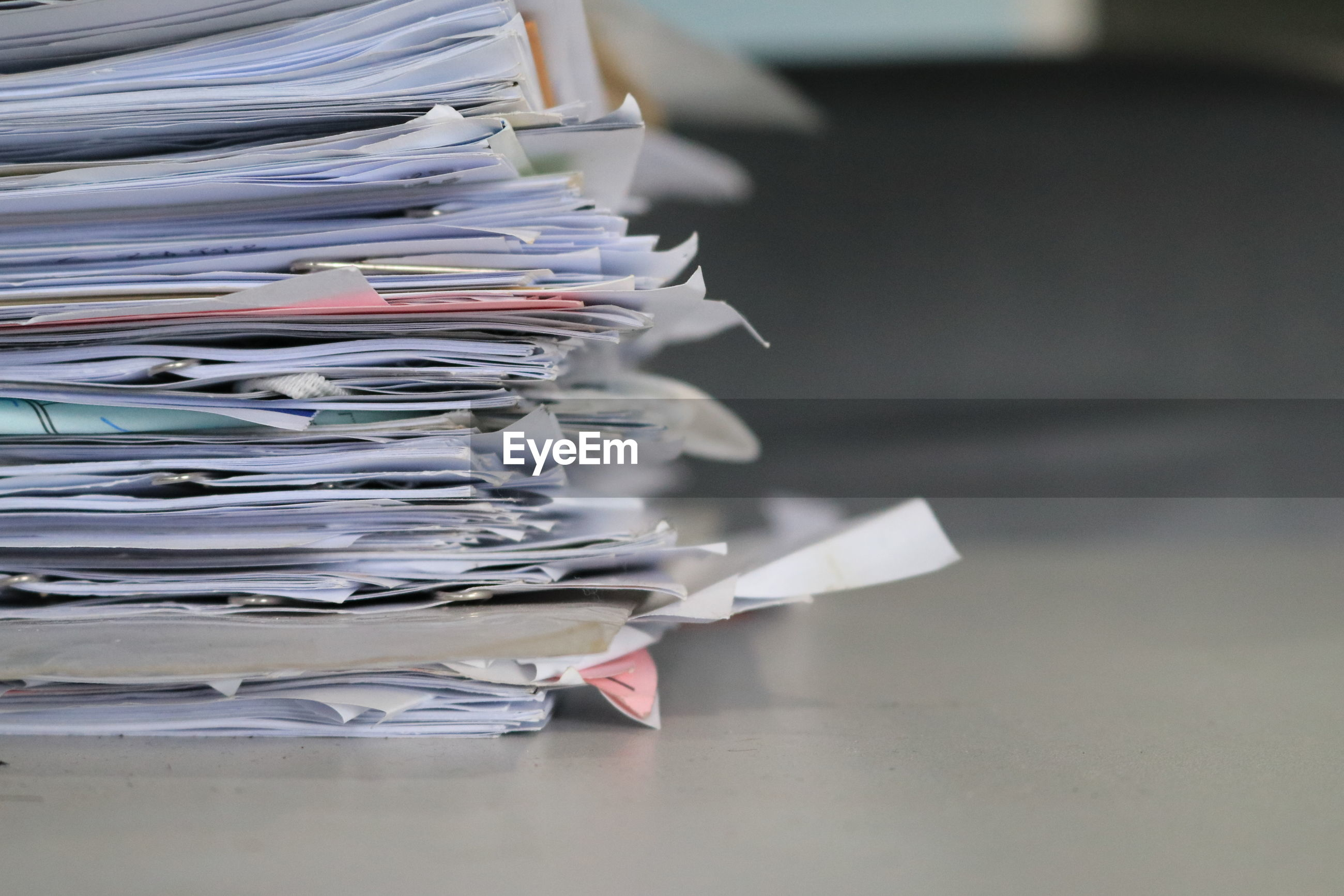 Close-up of stacked papers on table