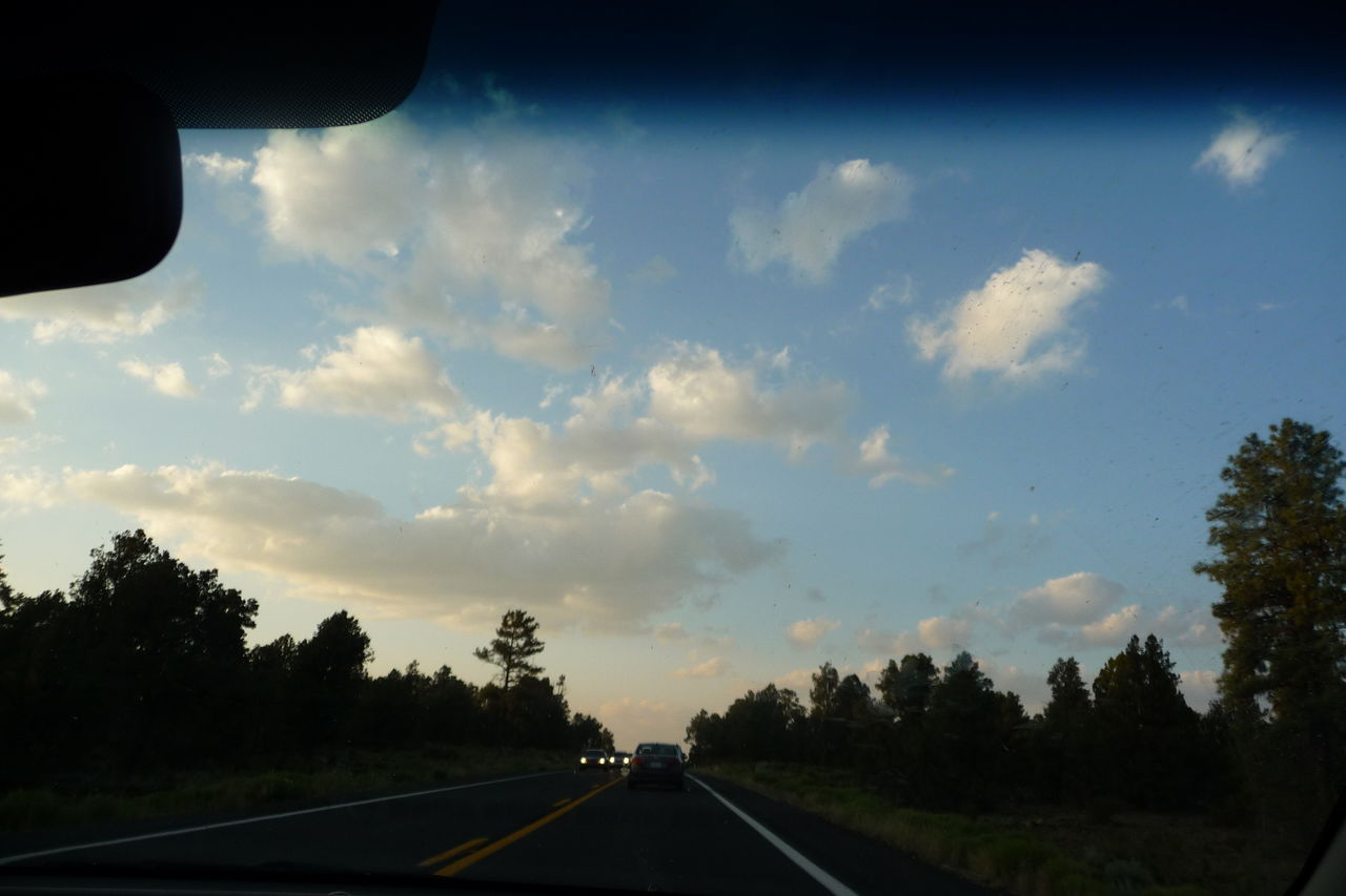transportation, road, vehicle interior, car, car interior, land vehicle, the way forward, mode of transport, windshield, sky, journey, tree, car point of view, driving, cloud - sky, travel, no people, road trip, day, sunset, nature, landscape, road sign, outdoors
