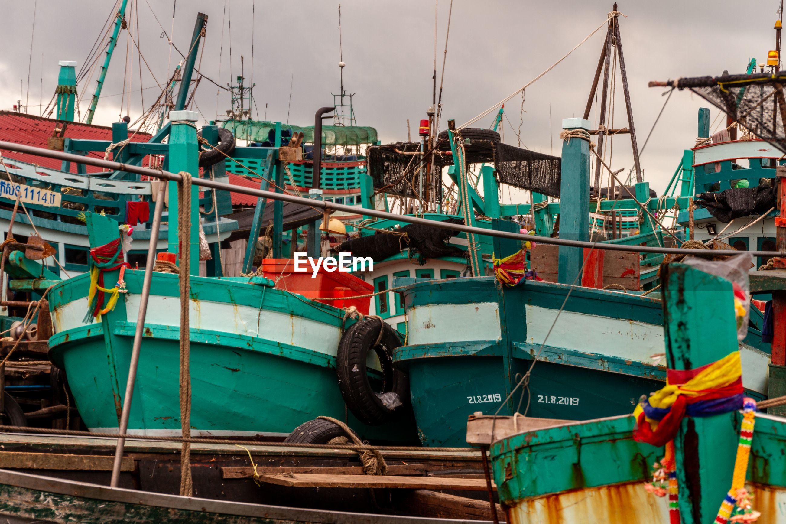 FISHING BOATS MOORED IN HARBOR