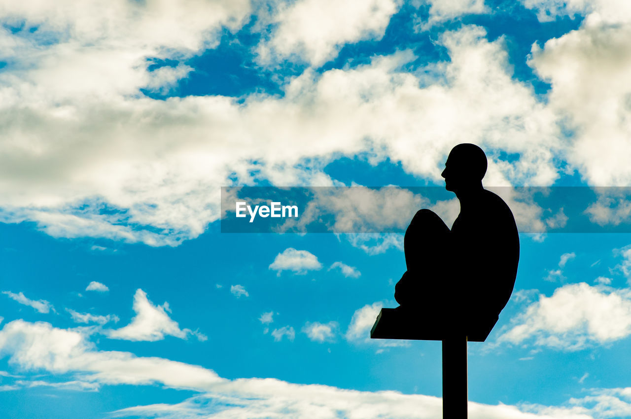 SILHOUETTE OF MAN AGAINST SKY