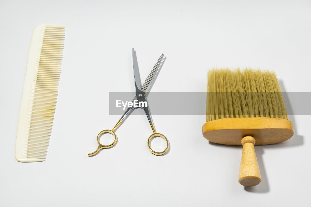 HIGH ANGLE VIEW OF EQUIPMENT ON TABLE AGAINST WHITE BACKGROUND
