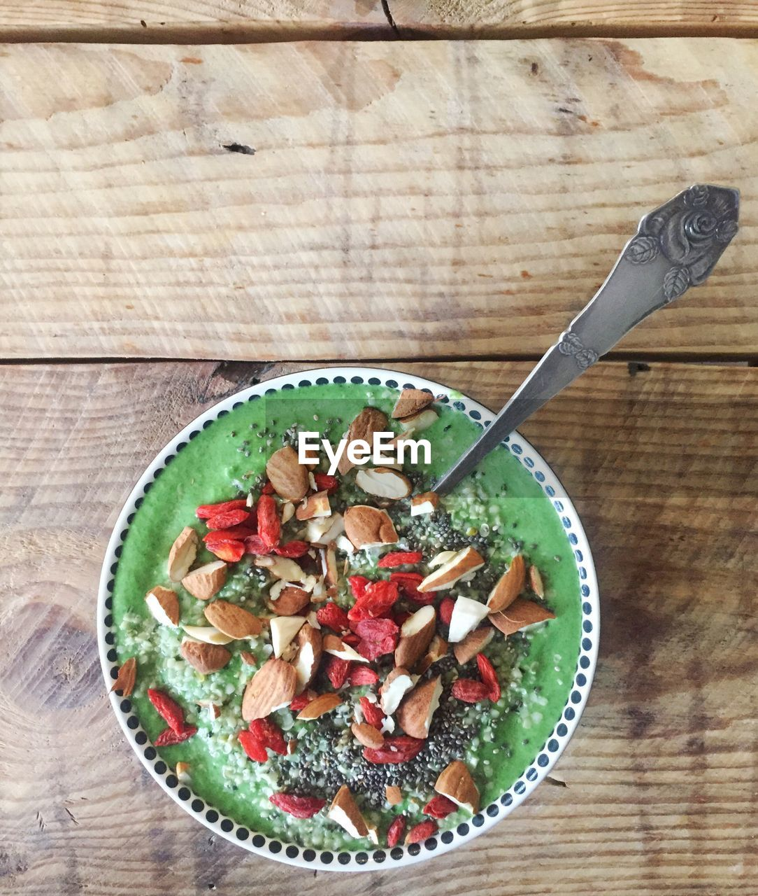 food and drink, food, healthy eating, eating utensil, kitchen utensil, wellbeing, table, freshness, spoon, bowl, directly above, fruit, wood - material, meal, indoors, high angle view, no people, breakfast, close-up, ready-to-eat, wood grain