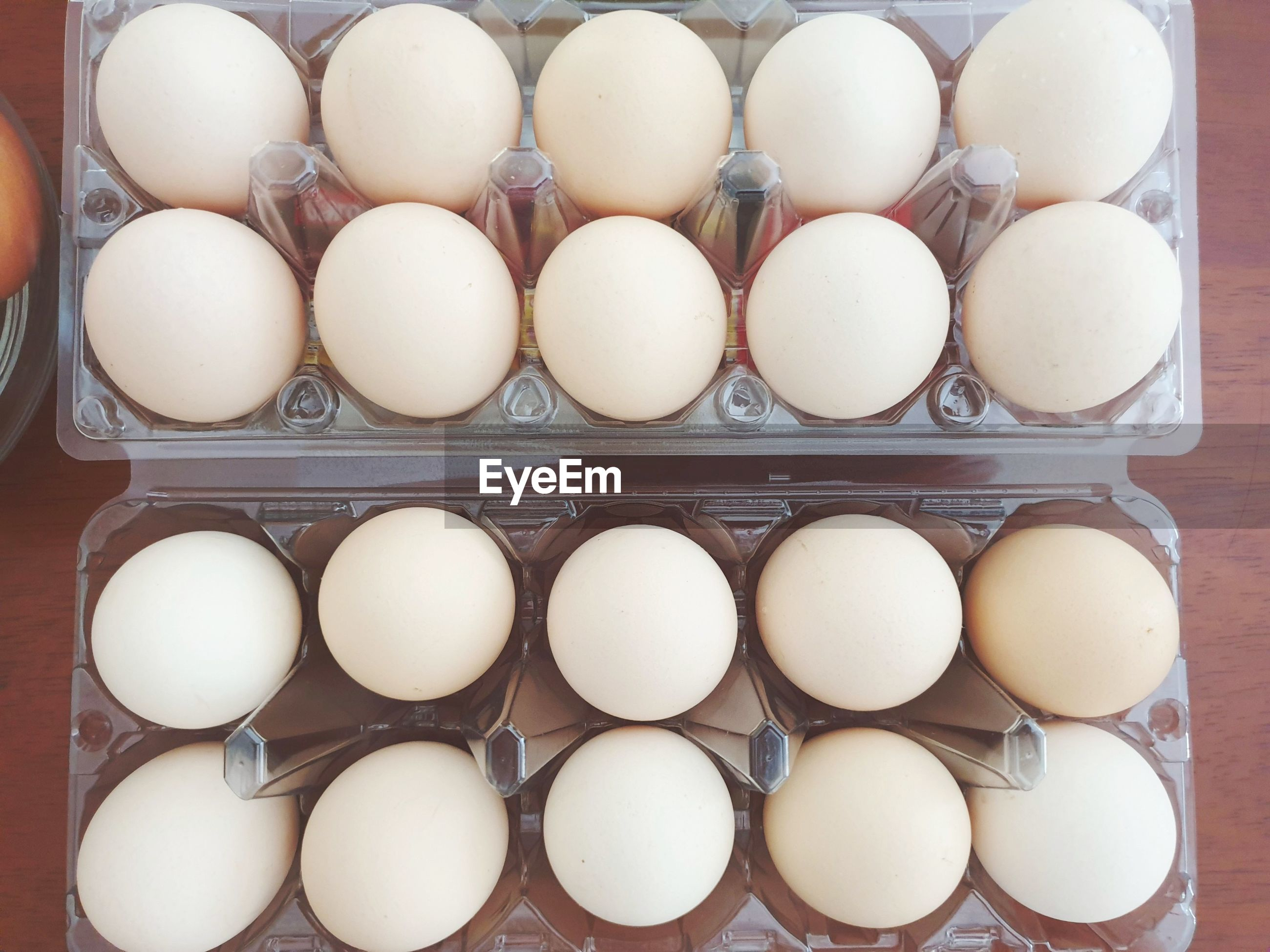 HIGH ANGLE VIEW OF EGGS IN CRATE ON WHITE BACKGROUND