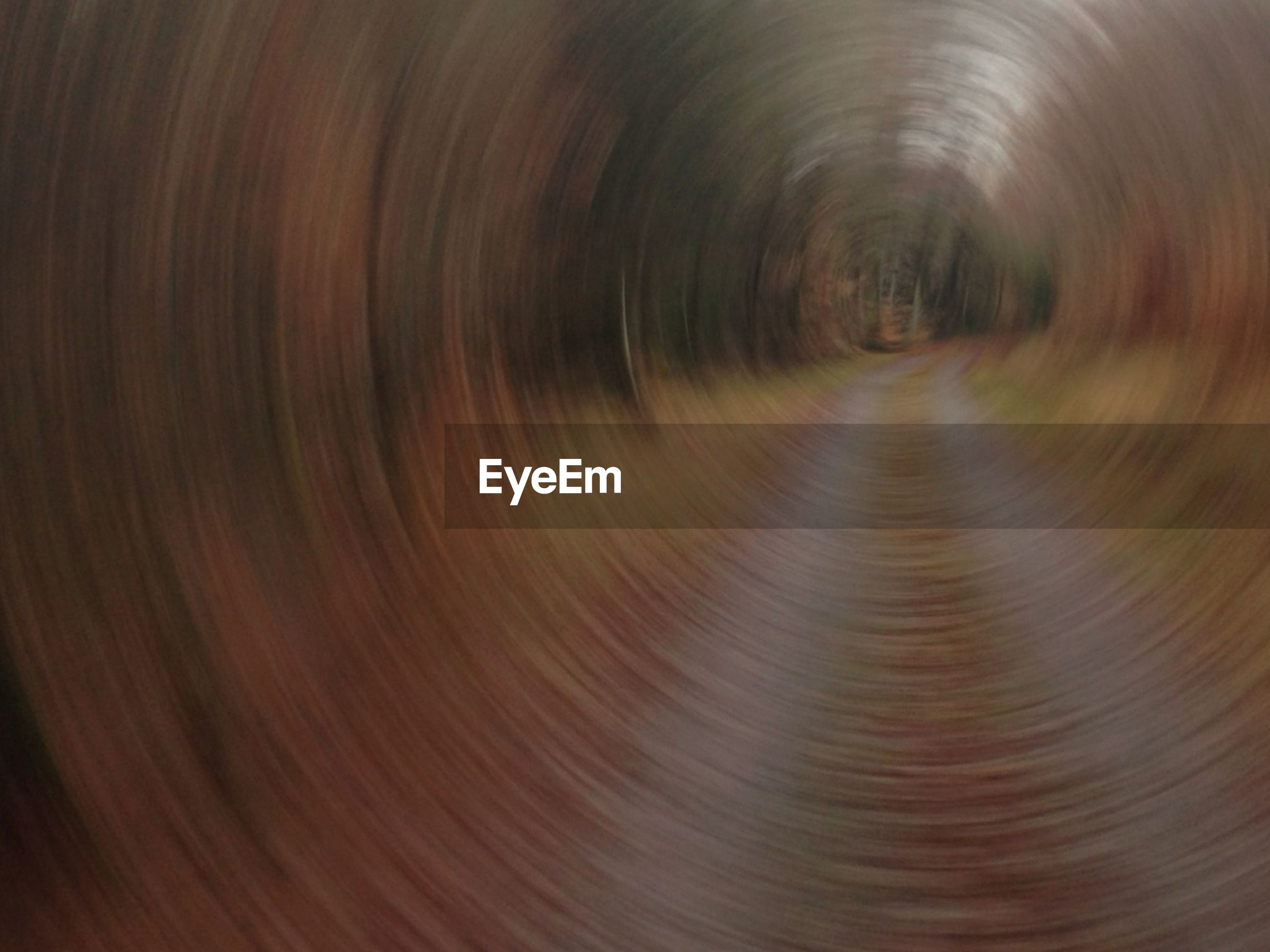 full frame, backgrounds, pattern, indoors, diminishing perspective, textured, the way forward, no people, close-up, abstract, vanishing point, tunnel, motion, circle, day, natural pattern, high angle view, blurred motion, design