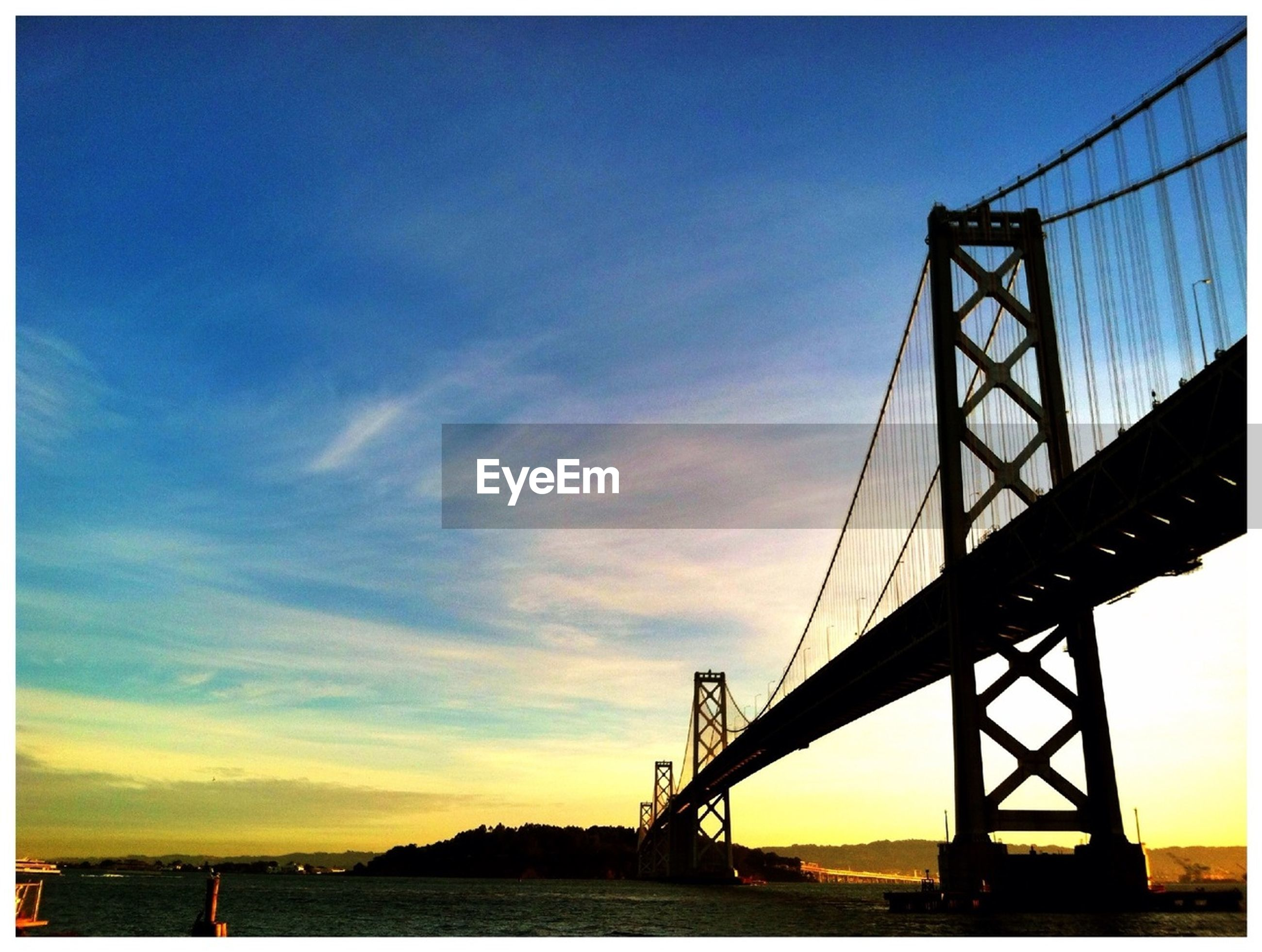 connection, sky, water, sunset, bridge - man made structure, sea, engineering, built structure, suspension bridge, bridge, architecture, transportation, tranquility, low angle view, tranquil scene, cloud - sky, nature, cloud, silhouette, scenics