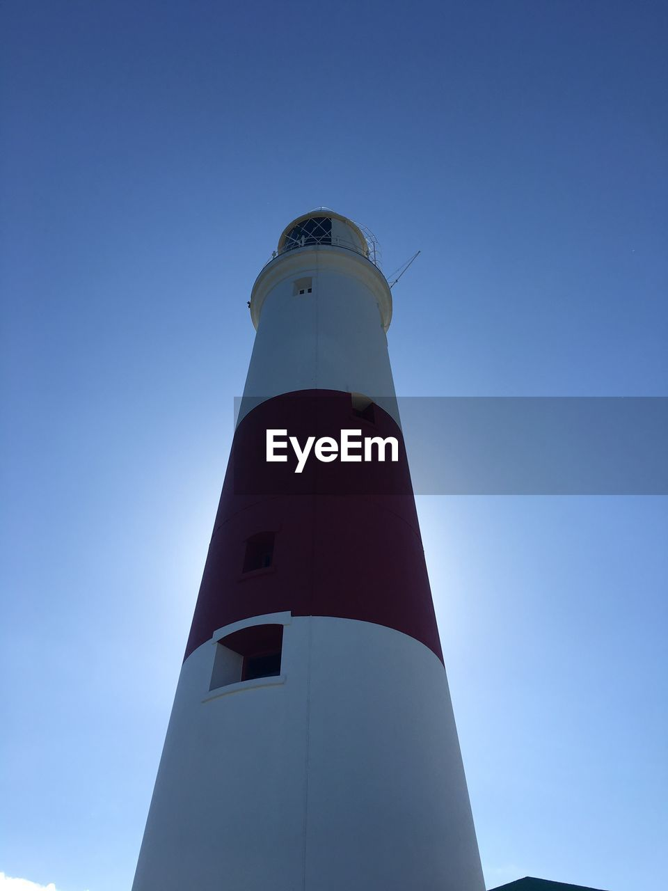 guidance, lighthouse, safety, protection, direction, security, tower, low angle view, architecture, building exterior, built structure, day, clear sky, outdoors, no people, blue, sky