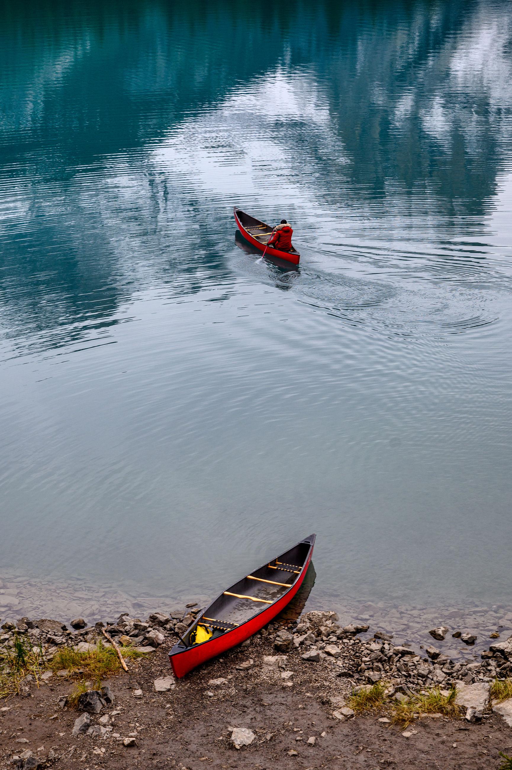 HIGH ANGLE VIEW OF MEN ON BOAT AT LAKE