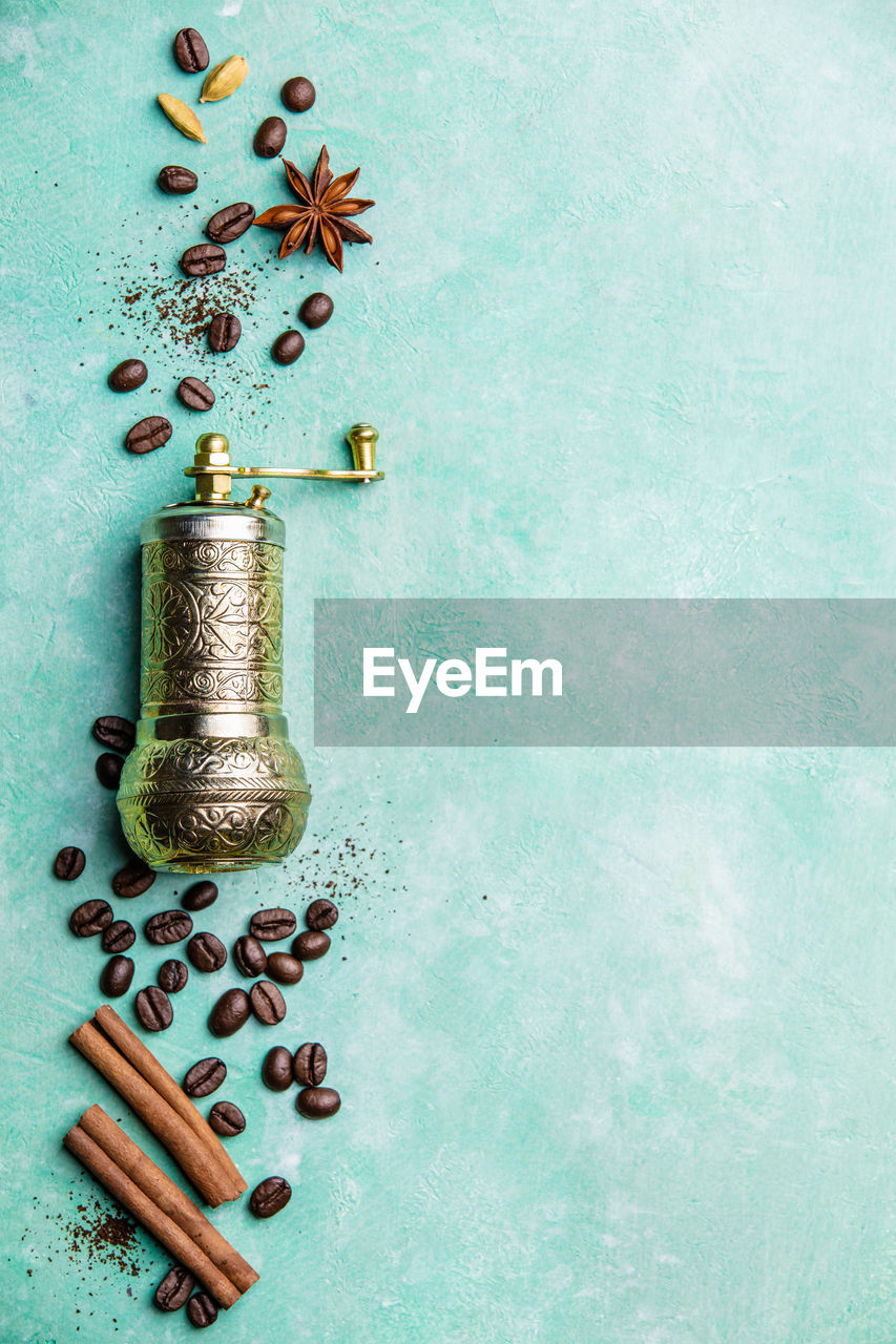 indoors, large group of objects, still life, spice, food and drink, studio shot, no people, food, roasted coffee bean, high angle view, celebration, copy space, freshness, metal, brown, black peppercorn, table, coffee - drink, container, plant