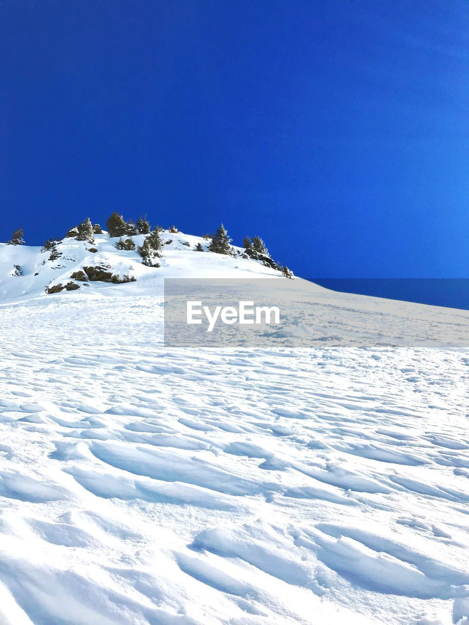 snow, winter, cold temperature, nature, tranquil scene, tranquility, beauty in nature, blue, scenics, white color, outdoors, clear sky, day, no people, mountain, landscape, sky