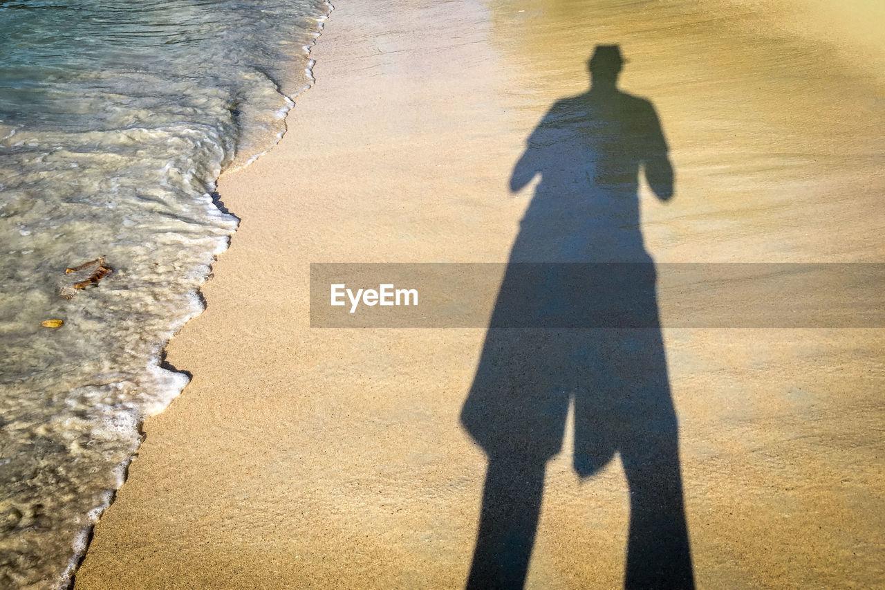 Shadow of man on beach