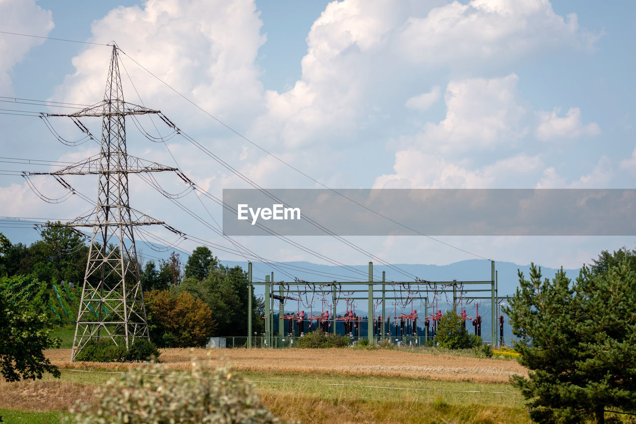 sky, cloud - sky, plant, technology, tree, electricity, cable, electricity pylon, connection, nature, fuel and power generation, power line, day, power supply, landscape, no people, architecture, land, built structure, field, outdoors, telephone line