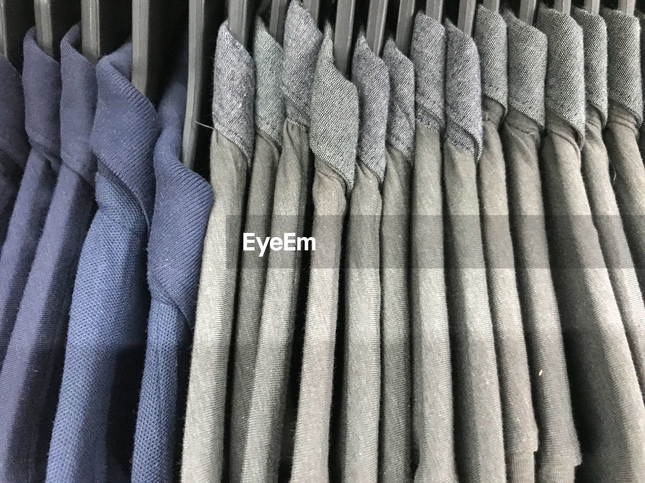 textile, no people, hanging, side by side, full frame, indoors, still life, clothing, backgrounds, large group of objects, in a row, close-up, pattern, choice, variation, arrangement, order, material, repetition, retail, menswear, warm clothing